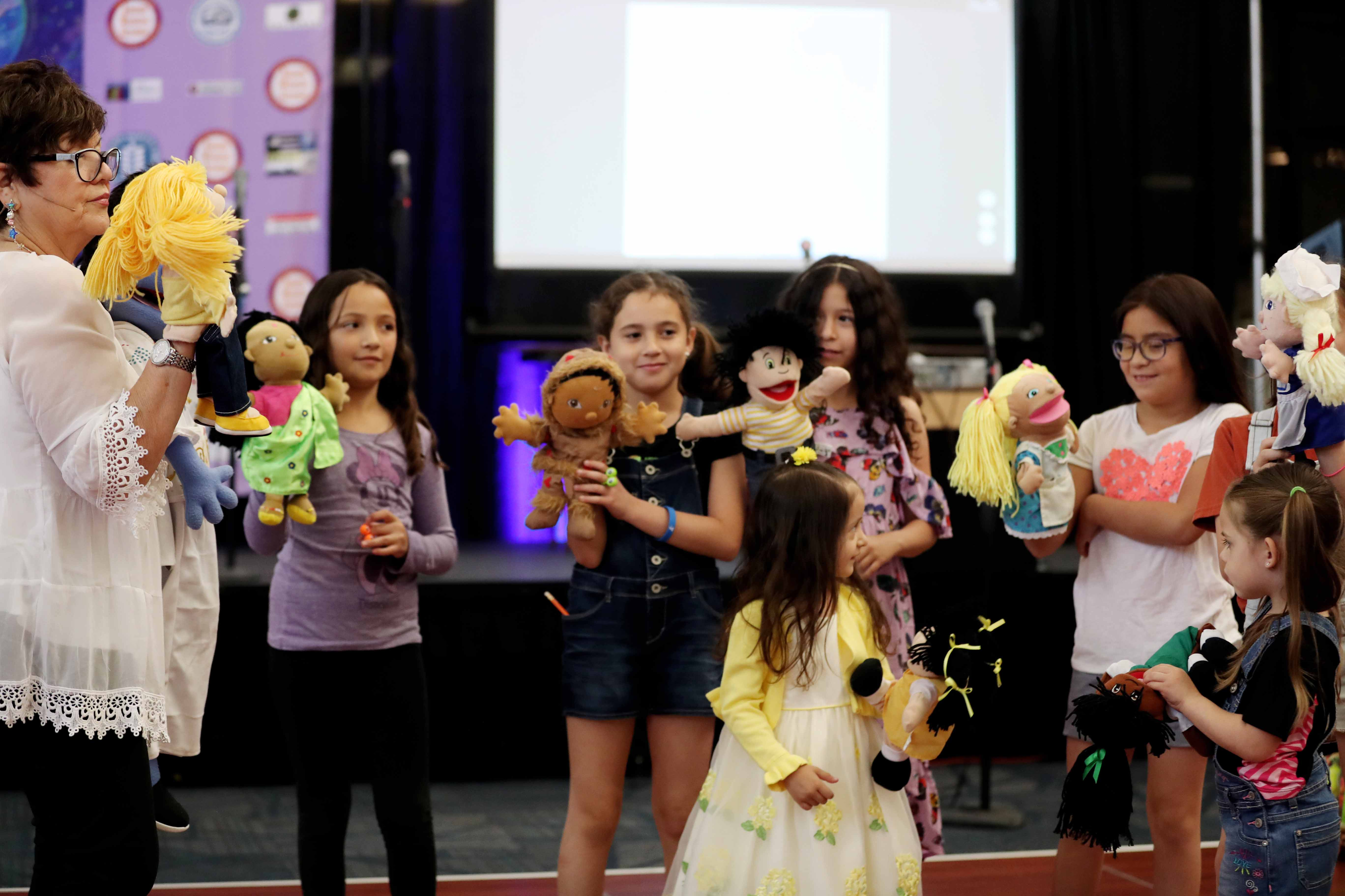 The book festival included activities such as puppetry.