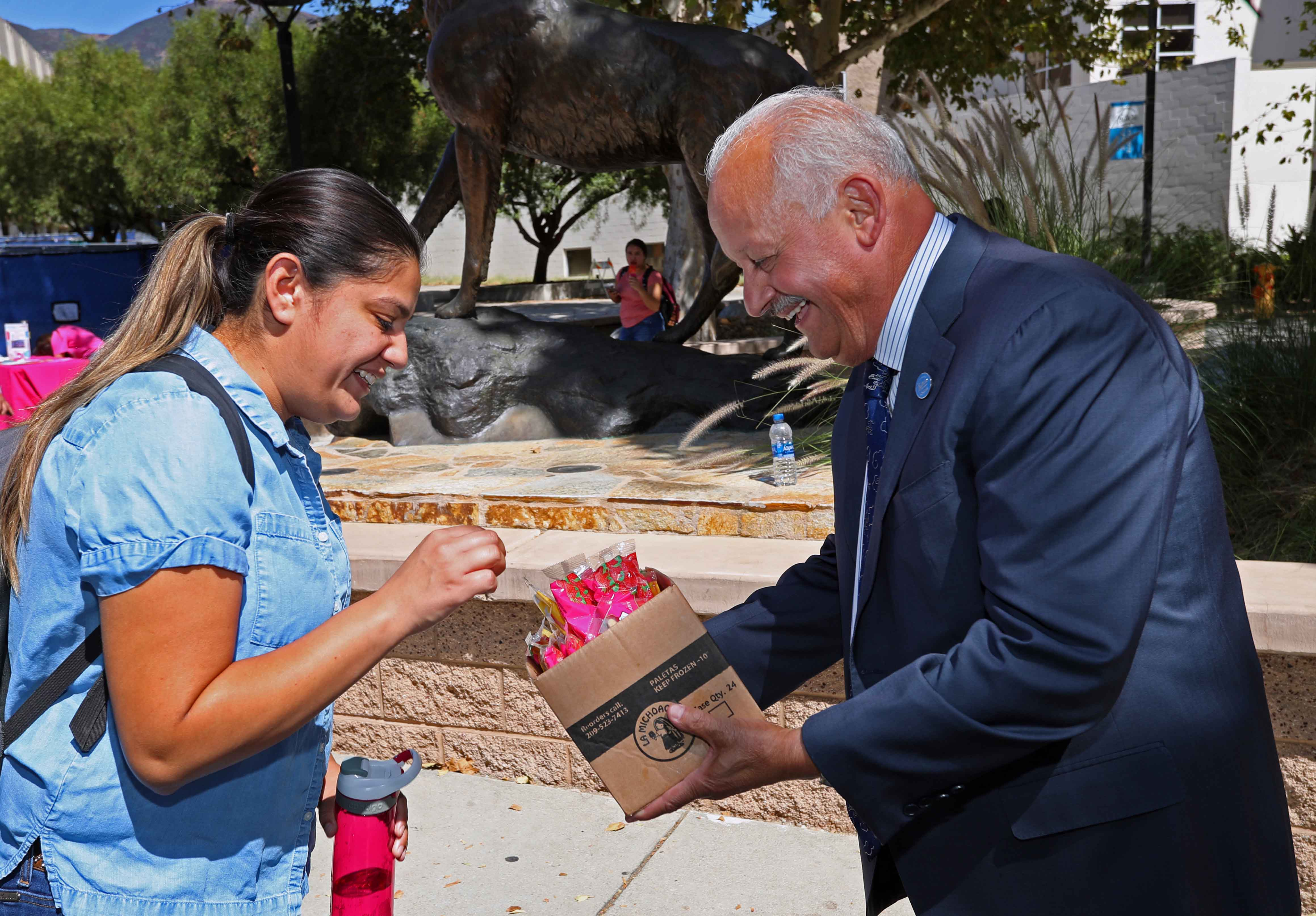 Cal State San Bernardino President Tomás D. Morales and the university's Orientation and First Year Experience handed out popsicles to students near the Wild Song statue on Sept. 23.