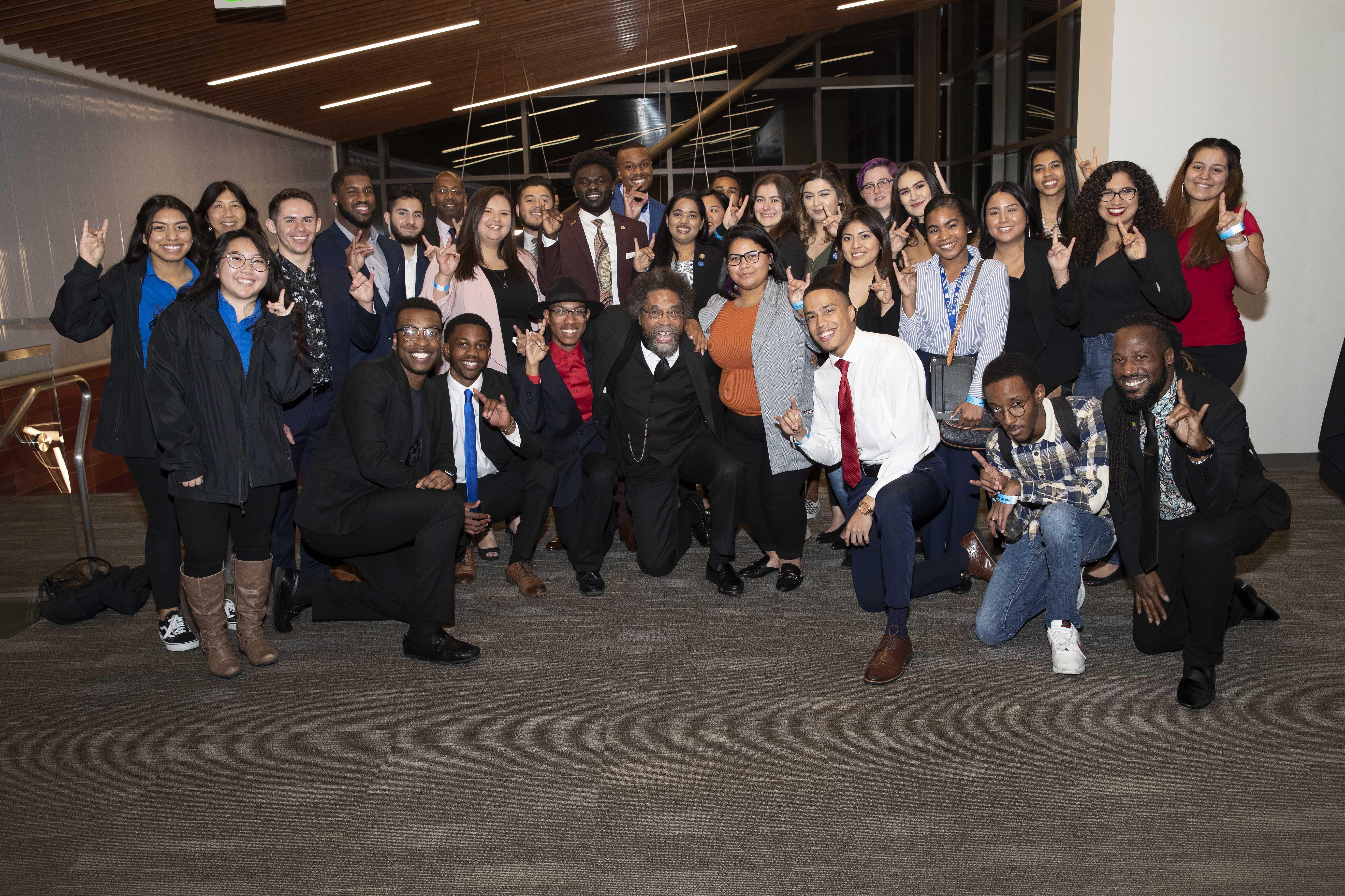 Cornel West, center, with CSUSB students, Jan. 25, 2019.