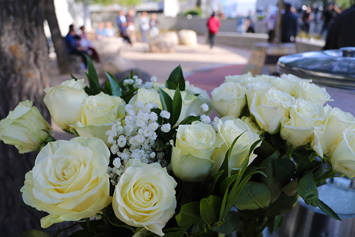 Flowers left in memory of those lost on Dec. 2, 2015, at the Peace Garden.