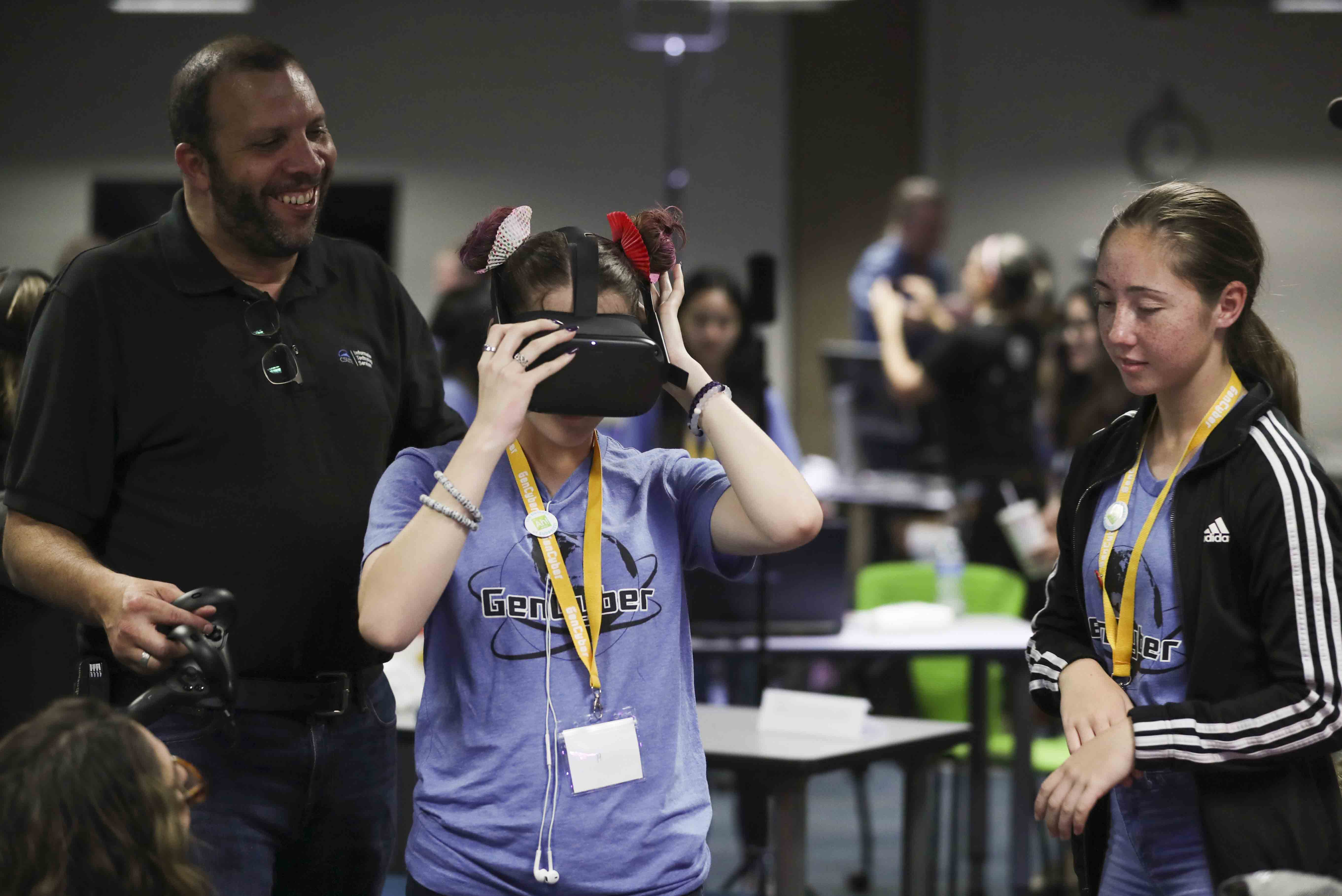Checking out a virtual reality headset at GenCyber camp.