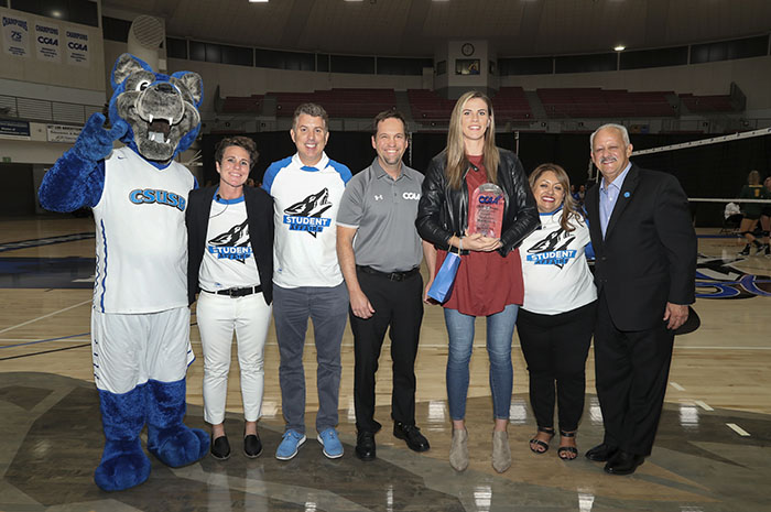 Former Coyote volleyball standout Samantha Middleborn (third from the right) was inducted into the CCAA Hall of Fame during the CSUSB-Cal Poly Pomona match.