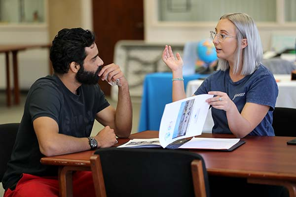 One-on-one discussions are the aim of The Human Library, created to challenge societal stereotypes and prejudices through positive dialogue. Photo: Corinne McCurdy/CSUSB